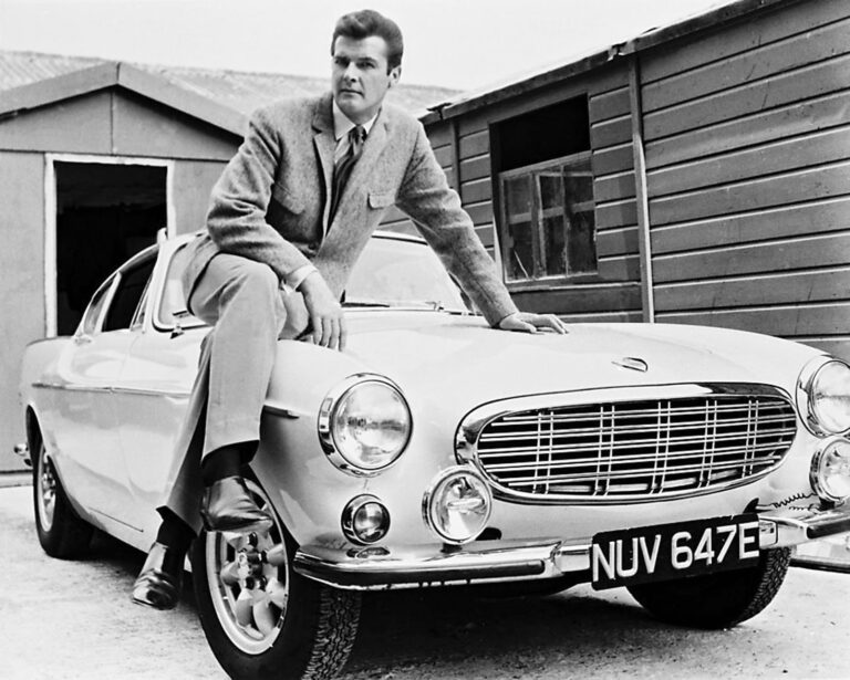 Roger Moore posing next to the p1800s from The Saint.